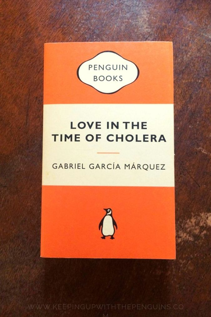 Love In The Time Of Cholera - Gabriel Garcia Marquez - Book Laid on Wooden Table - Keeping Up With The Penguins