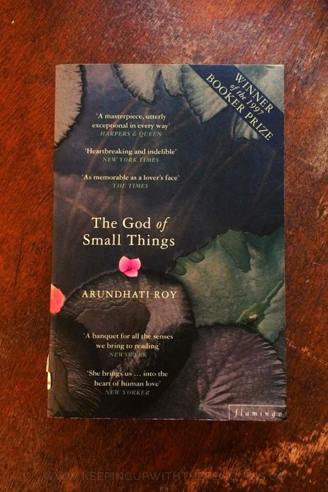 The God Of Small Things - Arundhati Roy - Book Laid on Wooden Table - Keeping Up With The Penguins