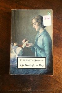 The-Heat-Of-The-Day-Elizabeth-Bowen-Book-Laid-on-Wooden-Table-Keeping-Up-With-The-Penguins