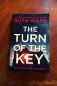 The Turn Of The Key - Ruth Ware - Book Laid on Wooden Table - Keeping Up With The Penguins