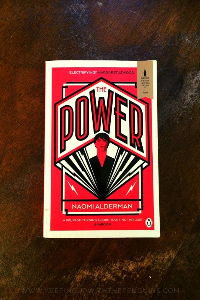 The Power - Naomi Alderman - Book Laid on Wooden Table - Keeping Up With The Penguins