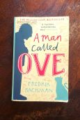 A Man Called Ove - Fredrik Backman - Book Laid on Wooden Table - Keeping Up With The Penguins