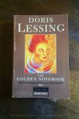 The Golden Notebook - Doris Lessing - Book Laid Face Up on Wooden Table - Keeping Up With The Penguins