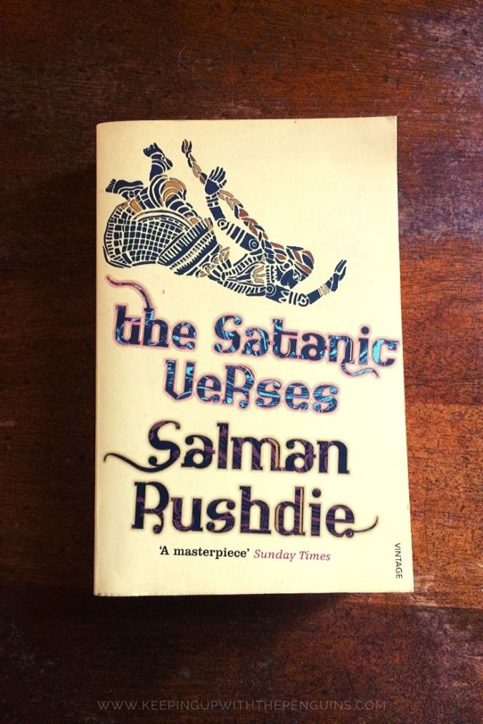The Satanic Verses - Salman Rushdie - Book Laid on Wooden Table - Keeping Up With The Penguins