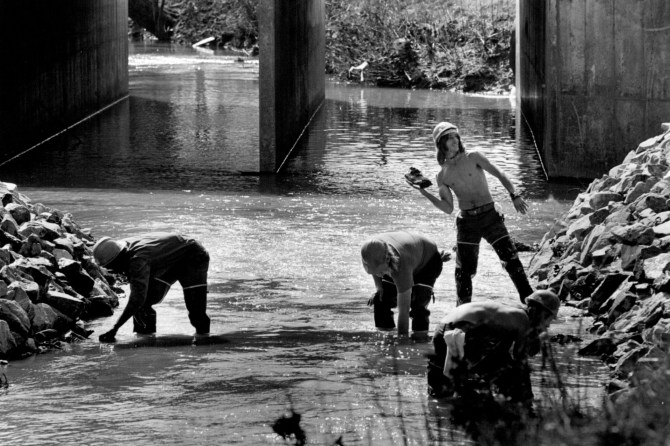 Workers put rocks along Briar Creek to try to stabilize its banks. March 1980 photo: Charlotte Observer archives