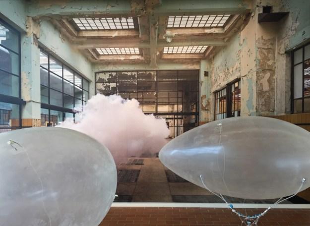 Both Jed Berk's Blubber Bots and Berndnaut Smilde's Nimbus Dumont together in the gallery.
