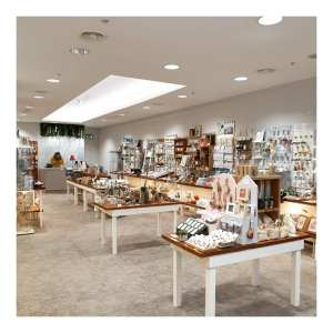 Inside a large gift shop called Canterbury Makes with table and wall displays