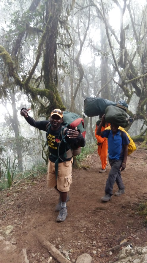 Guide Jackson in the rainforest with the porters