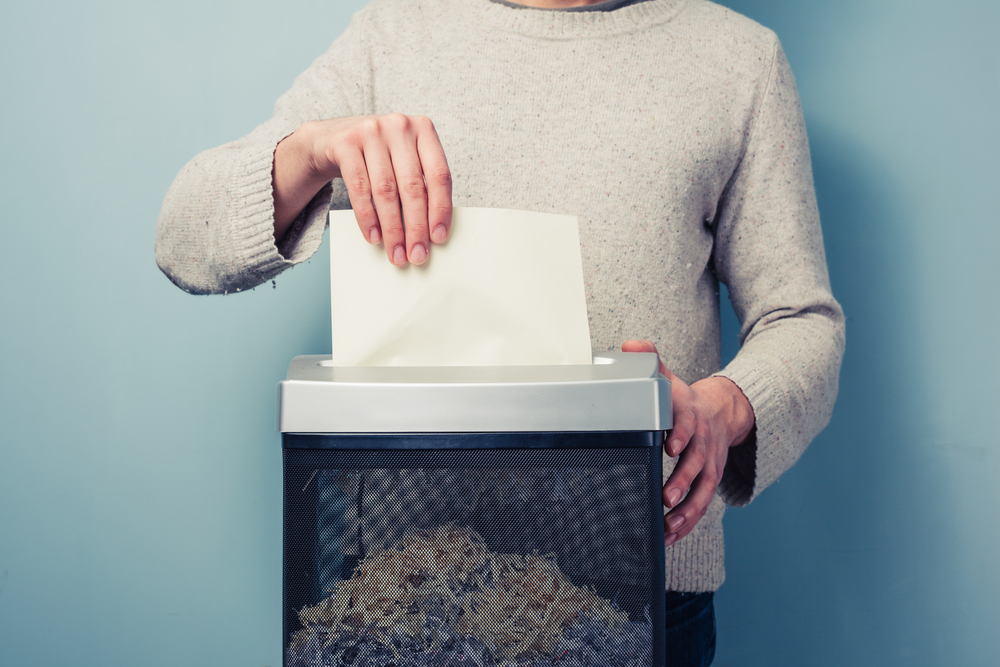 woman shredding paper
