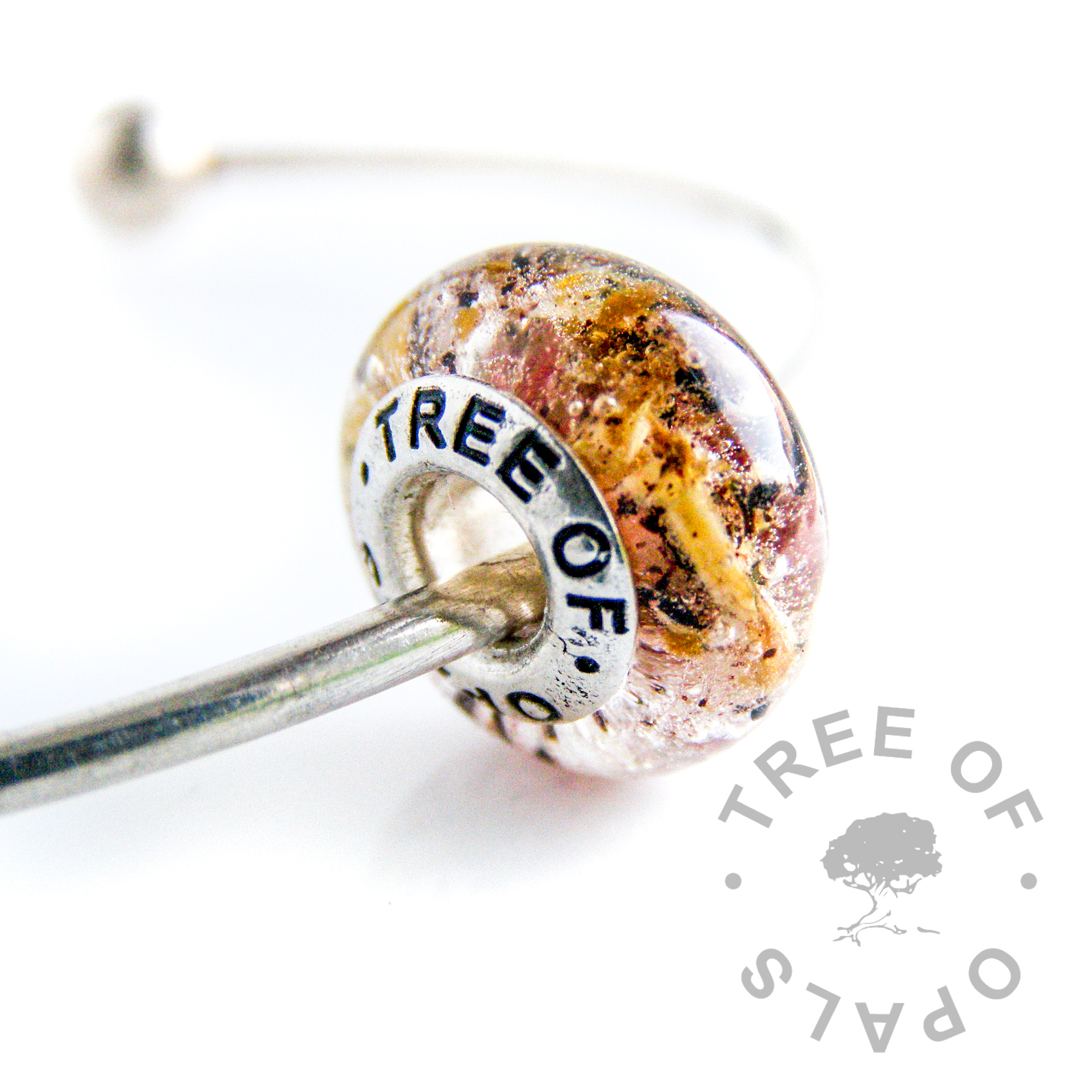 umbilical cord charm with a rose pink painted core, Tree of Opals solid silver core