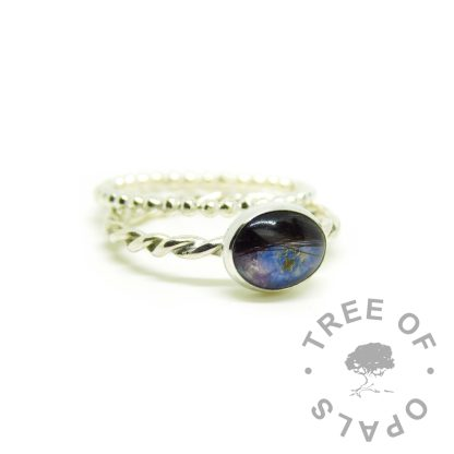hair jewellery rings with purple resin and a forget me not on a twisted band, shown with a slim stacking ring bubble band.