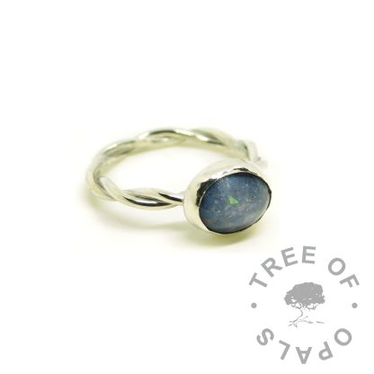twisted band memorial cremation ash ring with Aegean blue resin sparkle mix. Solid sterling silver setting