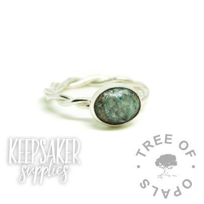 aqua ashes ring, cremation ashes ring on twisted band. Angelic aqua resin sparkle mix