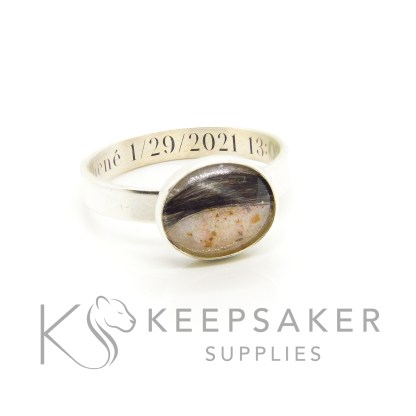 baby keepsake ring 3mm brushed band, 10x8mm bezel cup, breastmilk, umbilical cord and first curl. Engraved inside in Silver South Serif font. Breastmilk jewellery with cord and lock of hair