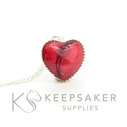 memorial keepsake heart necklace with a dog's fur. Dragon's blood red sparkle mix. Scalloped edge heart in solid Argentium silver. Over the rainbow bridge jewellery with fur
