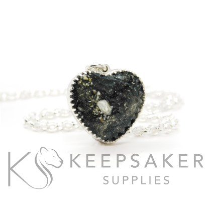 New style heart necklace setting with scalloped edge. Vampire black resin sparkle mix, cremation ashes, shown with a medium classic chain upgrade (mockup of new setting)