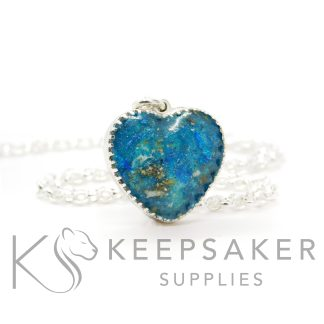 New style heart necklace setting with scalloped edge. Aegean blue resin sparkle mix, cremation ashes, shown with a medium classic chain upgrade (mockup of new setting)