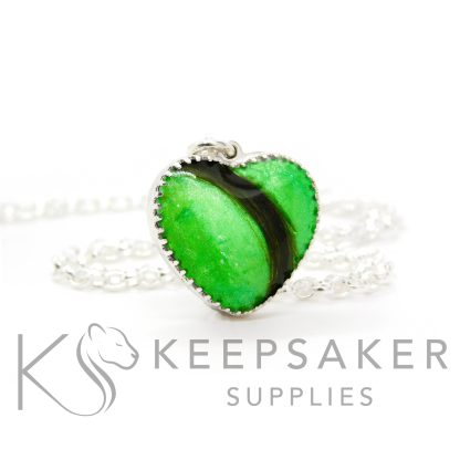 New style heart necklace setting with scalloped edge. Basilisk green resin sparkle mix, lock of hair, shown with a medium classic chain upgrade (mockup of new setting)