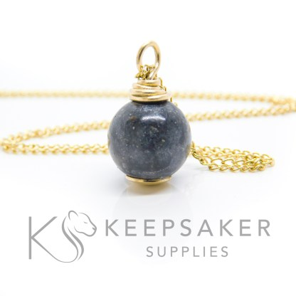gold cremation ashes orb, black sparkle mix, wire wrapped solid 9ct gold setting