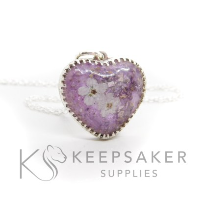 cremation ashes heart necklace with two white forget me nots, purple resin sparkle mix. Scalloped setting
