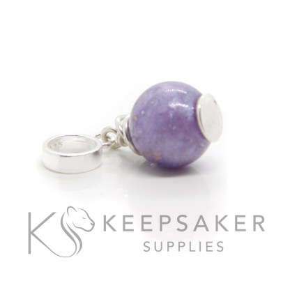 Cremation ashes orb with purple sparkle mix and wire wrapped European charm setting