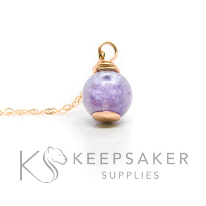 solid rose gold cremation ashes orb necklace, orchid purple resin sparkle mix. Shown with a simple necklace chain