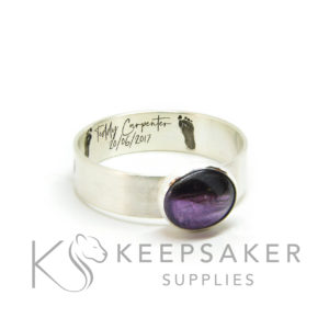 hair ring footprint engraving and font in Silver South Script. Dark hair and orchid purple resin sparkle mix 2D laser engraved jewellery