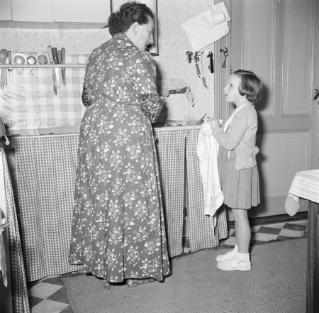 Helping to do the dishes vintage photo 1953