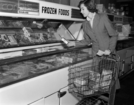 1950s Woman Shopping Frozen Food Section Of Grocery Store