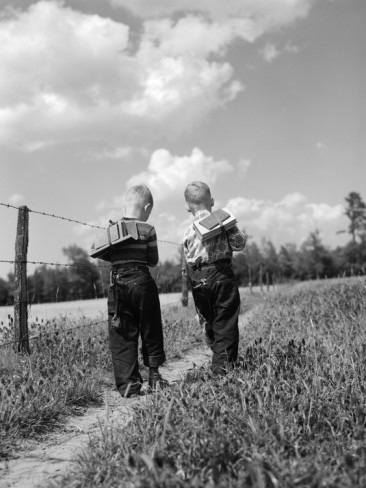 d-corson-two-boys-with-book-packs-walking-to-school