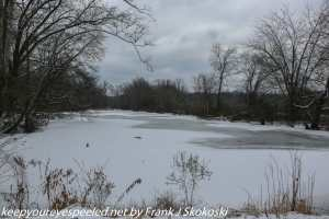 snow and ice covered pond