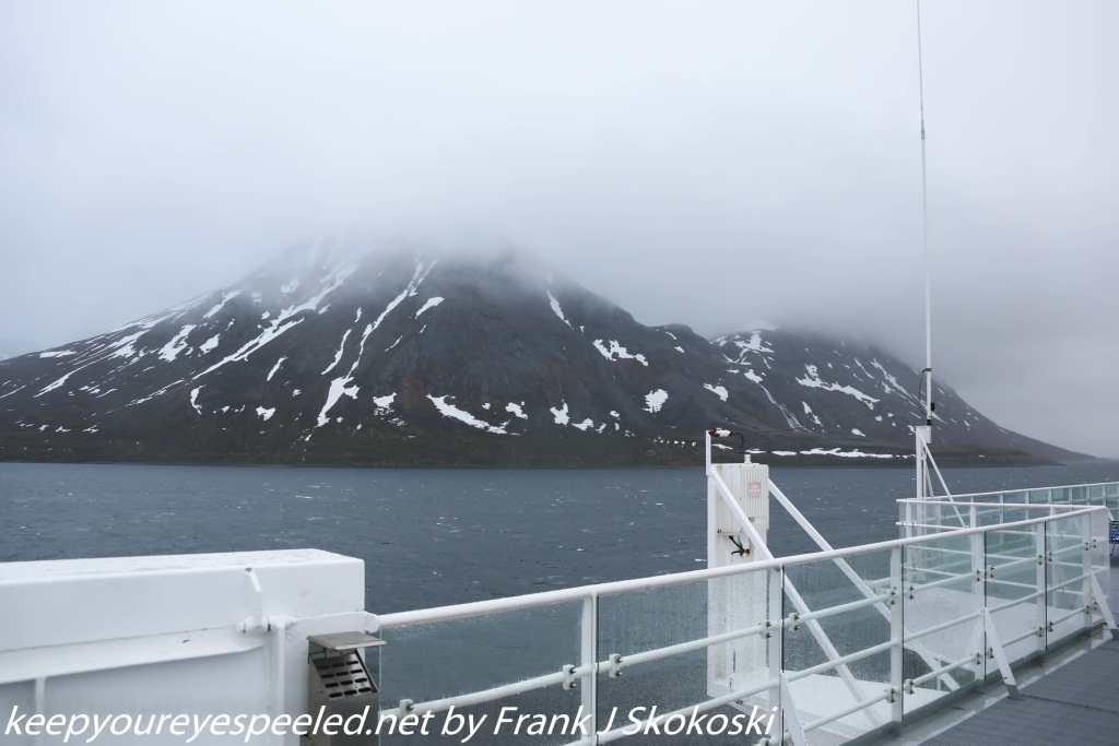 cloud shrouded mountains and ship