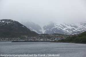 snow capped mountains and ship