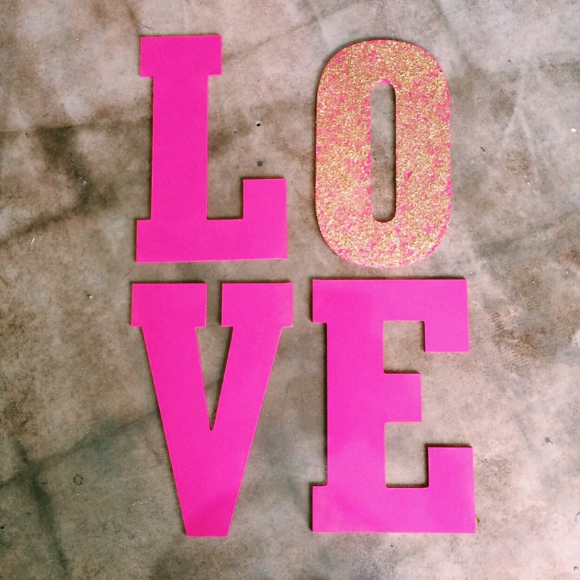 DIY love sign made with large MDF letters, acrylic paint, Mod Podge, and glitter. keiralennox