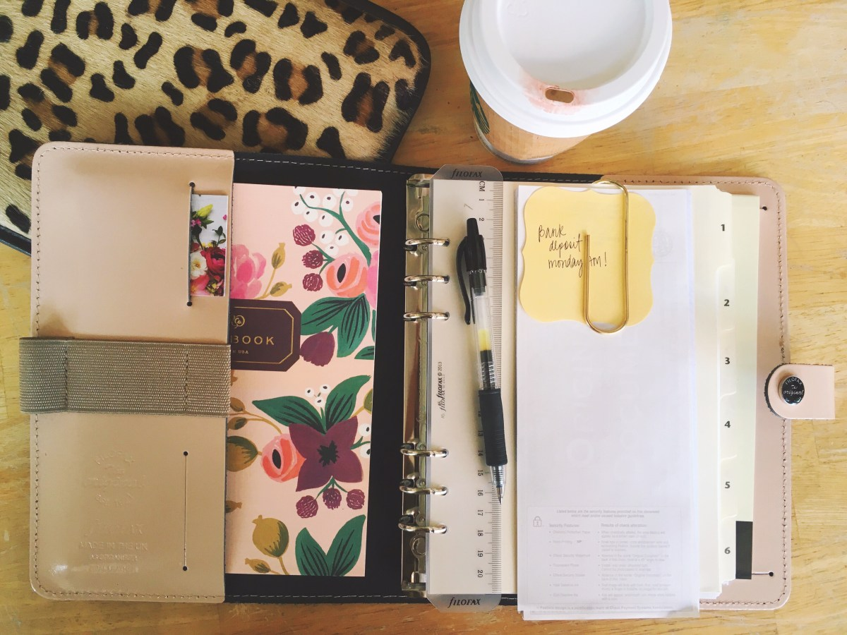 Open Filofax A5 Original Organizer in Patent Nude with Rifle Paper Co. floral notebook , leopard print iPad sleeve and coffee cup on a desk.