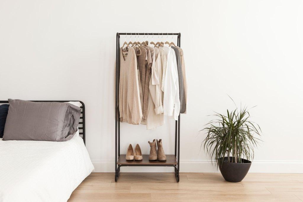 Capsule Wardrobe Planning, IRIS USA, Inc. IRIS Metal Garment Rack with Wood Shelf, Black and Dark Brown $39.99 at Walmart
