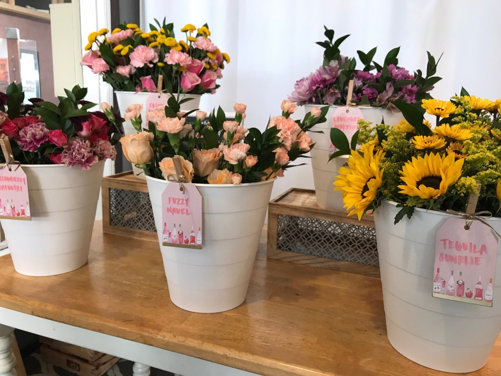 DIY Bouquet Bar with buckets of fresh flowers named after specialty cocktails