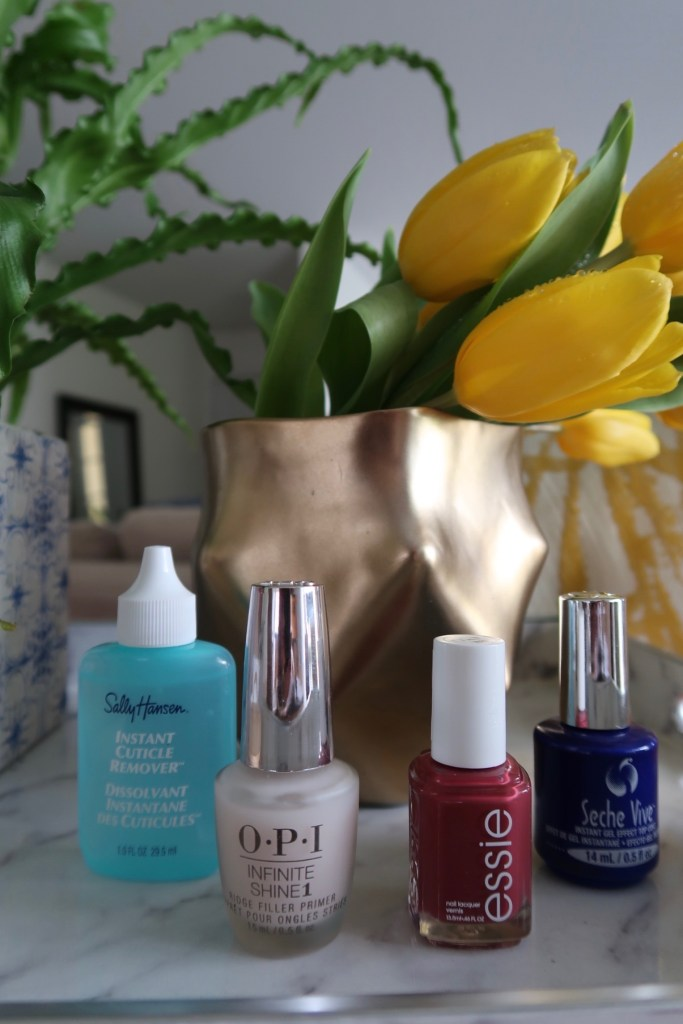 Best products for home manicure kit: Sally Hansen Instant Cuticle Remover, OPI Infinite Shine Ridge Filler Primer, Essie 'stop, drop & shop' from fall 2018 color collection; Seche Vita Instant Gel Effect Top Coat.