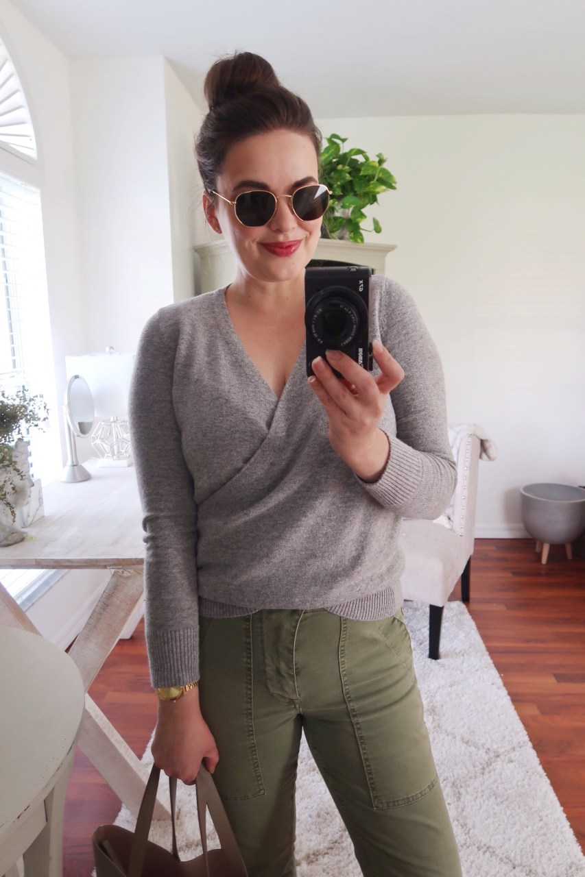 Style blogger wearing gray LOFT wrap sweather with olive J.Crew cargo chinos and Ray-ban hexagon sunglasses, holding a Cuyana structured leather tote.