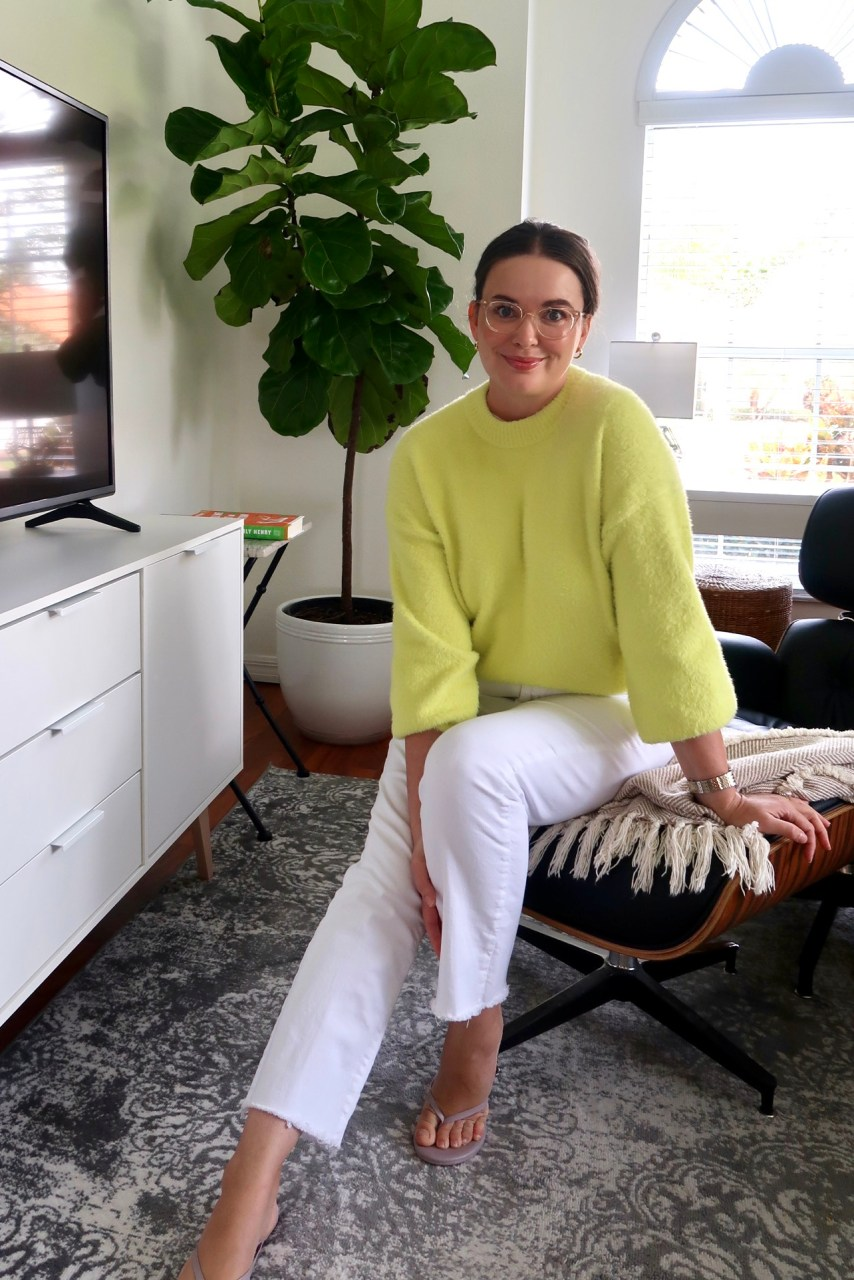 Style blogger at home wearing chartreuse fuzzy sweater and white Zara jeans