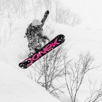 Katie Tsuyuki snowboarding in Niseko backcountry