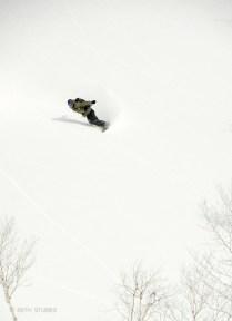 Jamie Thompson flying in the Niseko Backcountry