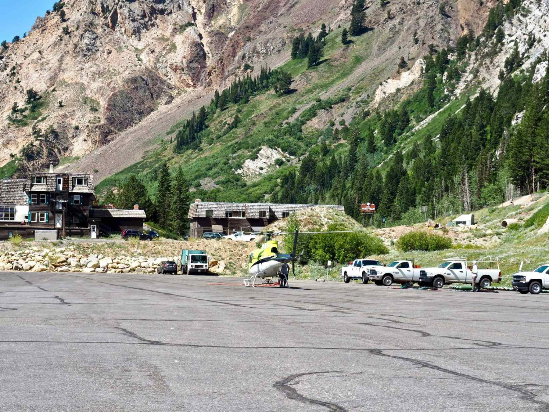 helicopter preparing the mountain for winter - Alta parking lot