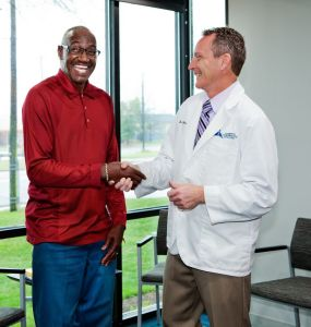 Man Shaking Hands With Doctor