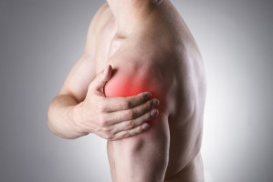 Man with pain in shoulder.