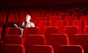 Man-Sitting-Alone-In-Empt-001