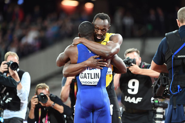 Usain Bolt and Justin Gatlin embrace