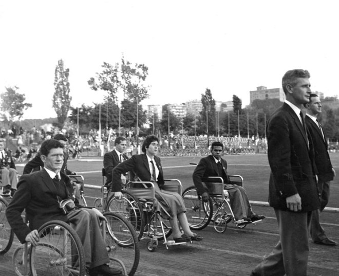 Members of the Australian Paralympic Team, led by Team official Kevin Betts, march in the Opening Ceremony of the 1960 Rome Paralympic Games