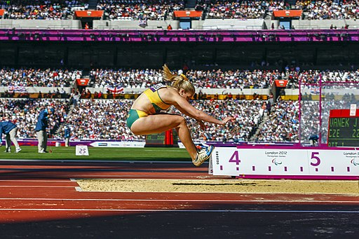 A photograph of Katy Parrish competing in the long jump at the 2012 London Paralympic Games.
