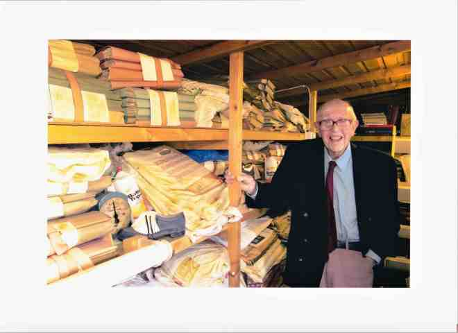 A photograph of Charles Reep in his garden shed with his archive of papers.